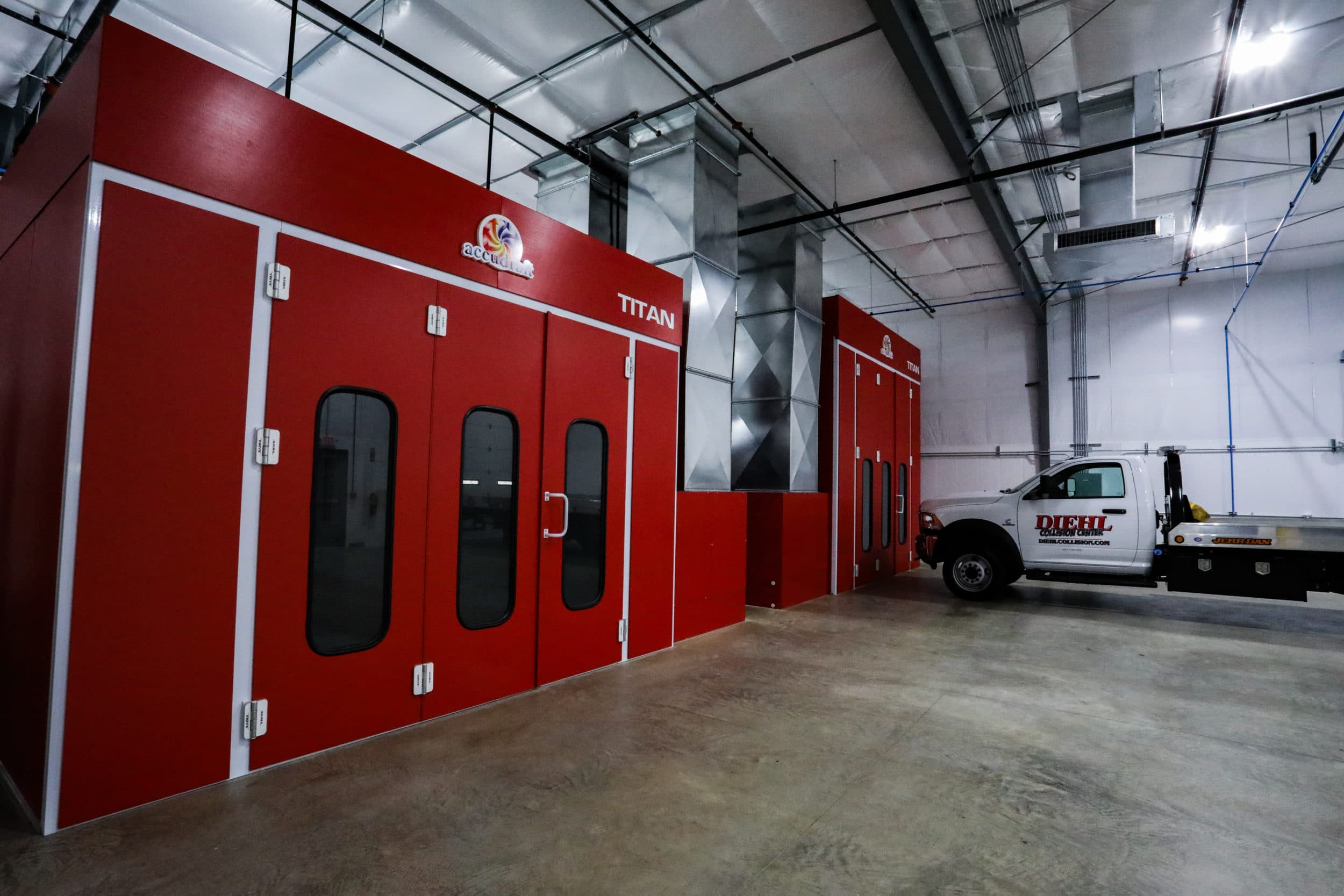 Accudraft Titan paint booth in red for collision repair shop