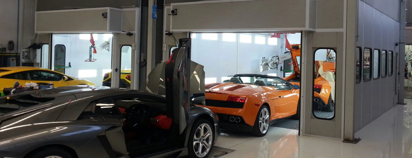 Luxury cars inside a paint booth