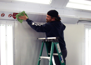 Accudraft maintenance team servicing a paint booth