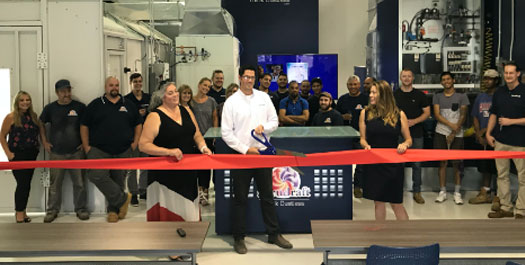 Accudraft team cutting a ribbon at their training facility